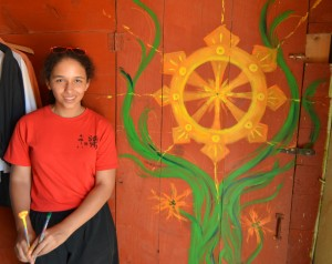 Magalie and her mural creation